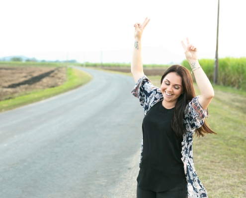 Shanny Matterson from Wild Spark Copy raising her hands in the air