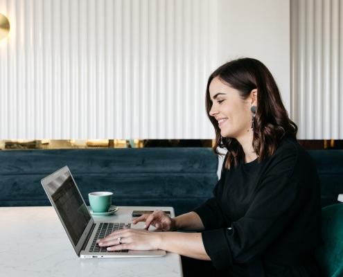 Leanne Webber with Laptop at Desk