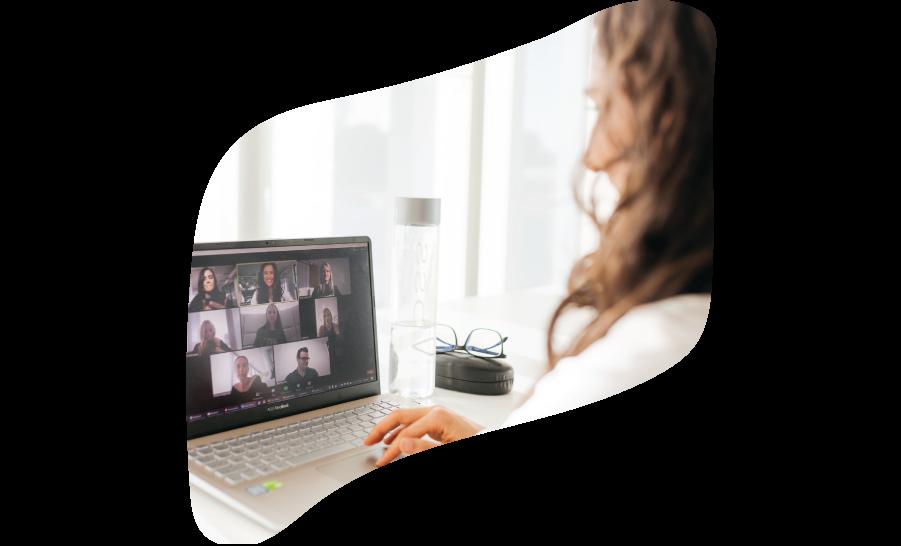 Founders Team Member Enjoying her Virtual Mastermind on Laptop